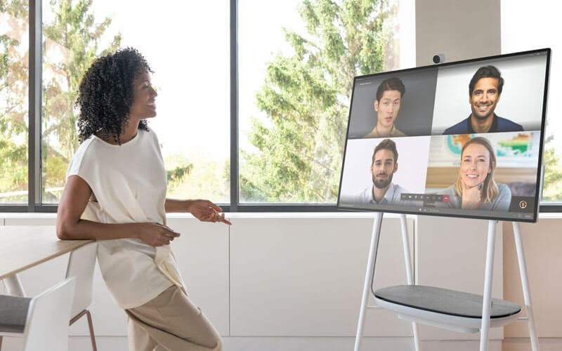 Woman using Surface Hub 2S for web meeting